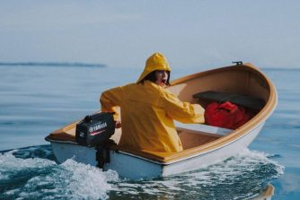 Benee steering a small boat
